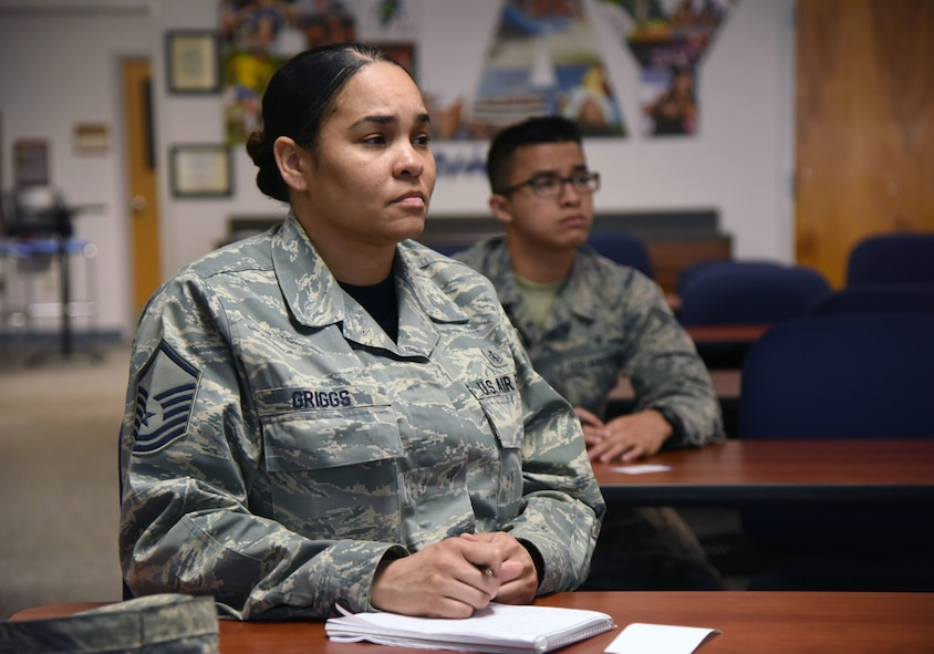 """Master Sgt. Dennise Griggs, 81st Diagnostic and Therapeutics Squadron histopathology NCO in charge, and Airman 1st Class Nathaniel Gomez, 81st Dental Squadron dental technician, attend a """"TSP Lunch N' Learn with Liza"""" financial savings class at the Sablich Center March 2, 2018, on Keesler Air Force Base, Mississippi. The session was one of three held during military saves week. (U.S. Air Force photo by Kemberly Groue)"""