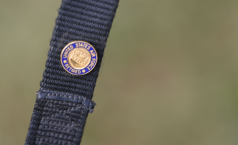 A retirement pin rests on the collar of a Military Working Dog at the MWD Retirement Ceremony Feb. 23, 2018, at the Air Base theater. Retirement ceremonies honor the service given to the military from its members, including MWDs. This retirement ceremony honored three of Joint Base Charleston's MWDs -- Shark, Chico and Jaga – for their valued service.