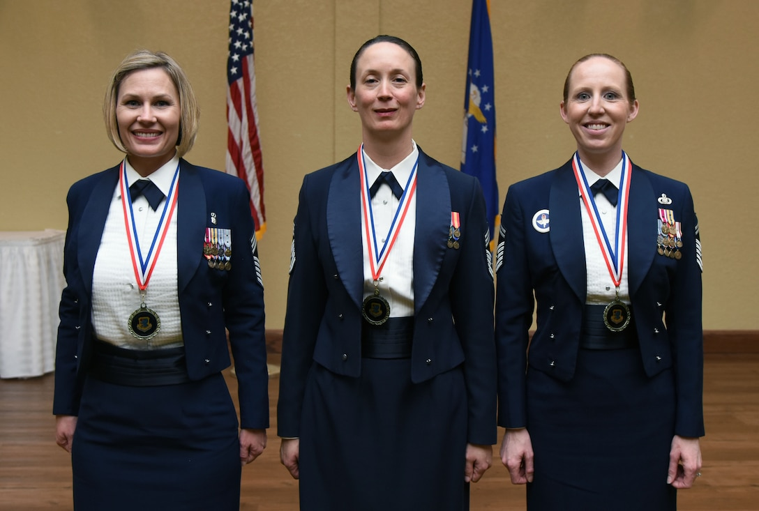 Keesler's newest chief master sergeants, Chief Master Sgt. Jacey McDuffie, 81st Diagnostic and Therapeutics Squadron pharmacy flight lead; Chief Master Sgt. Jolynn Kari, 81st Medical Support Squadron functional manager, and Senior Master Sgt. Jessika Dowdy, 334th Training Squadron command and control training flight superintendent, pose for a photo during the Chief Induction Ceremony at the Bay Breeze Event Center March 1, 2018, on Keesler Air Force Base, Mississippi. Three Keesler Airmen earned their chief master sergeant stripe during the 2018 promotion release. (U.S. Air Force photo by Kemberly Groue)