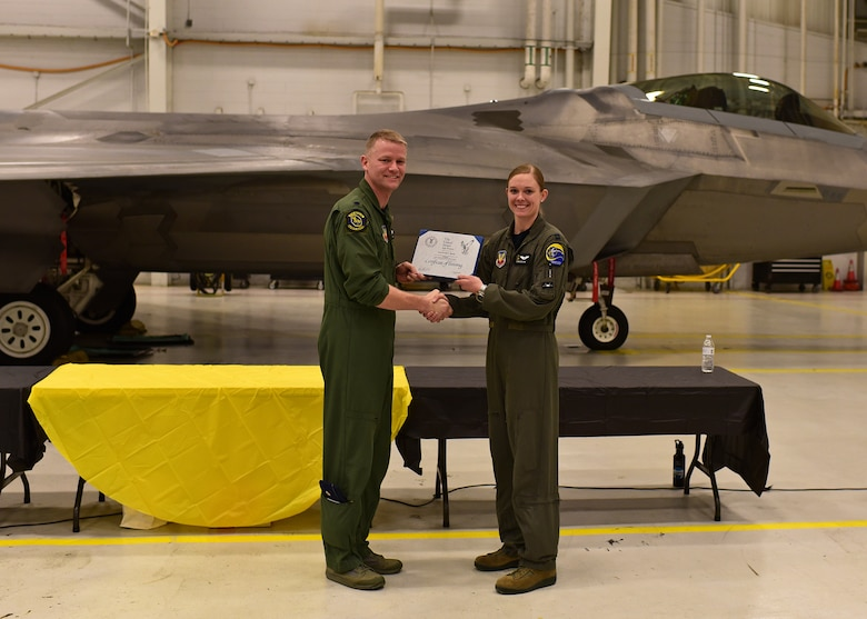 Airman receives certificate.