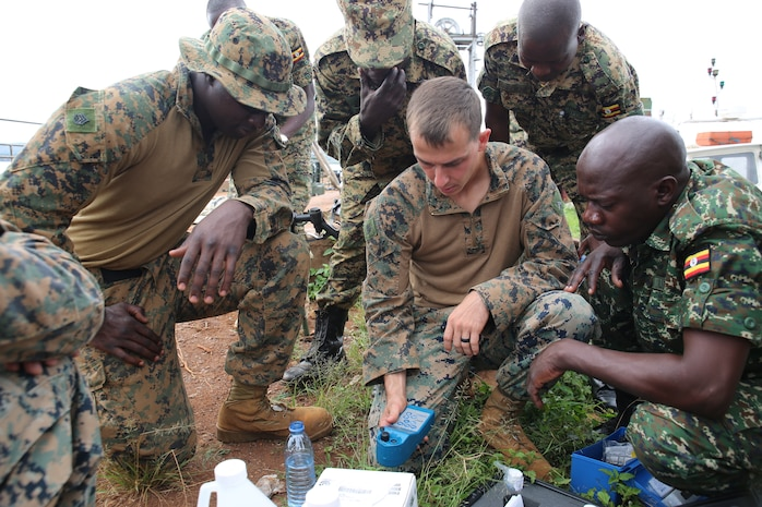A U.S. Marine assigned to Special Purpose Marine Air-Ground Task Force-Crisis Response-Africa tests water alkalinity during a water purification exercise in Jinja, Uganda, Dec. 5, 2017. SPMAGTF-CR-AF is deployed to conduct limited crisis-response and theater-security operations in Europe and Africa.