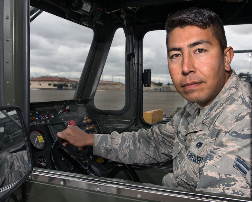 Airman 1st Class Mohammad Javad from the 60th Aerial Port Squadron, Travis Air Force Base, Calif., poses for a photo, Feb. 28, 2018. Javad was a linguist for U.S. forces while living in Afghanistan and fled to the United States in 2014. After a year in the U.S. Javad enlisted in the U.S. Air Force. (U.S. Air Force photo by Louis Briscese)