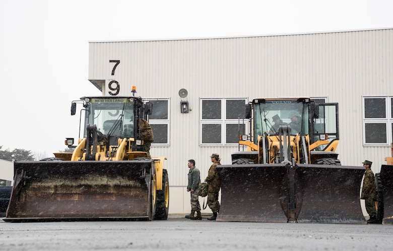 Japan Ground Self-Defense Force Soldiers from the 1st Training Unit at Camp Higashi-Chitose, Hokkaido, Japan, tour a front end loader and a v-plow with U.S. Air Force Airmen with the 35th Civil Engineer Squadron at Misawa Air Base, Japan, March 5, 2018,. Misawa AB works with JGSDF Soldiers to complete their basic English course final evaluation by attending a career field exchange with their U.S. Air Force counterparts practicing military English terms. The course, held at Camp Higashi-Chitose, Hokkaido, Japan, enhances future bilateral missions and enables seamless execution by breaking down social barriers. (U.S. Air Force photo by Senior Airman Sadie Colbert)