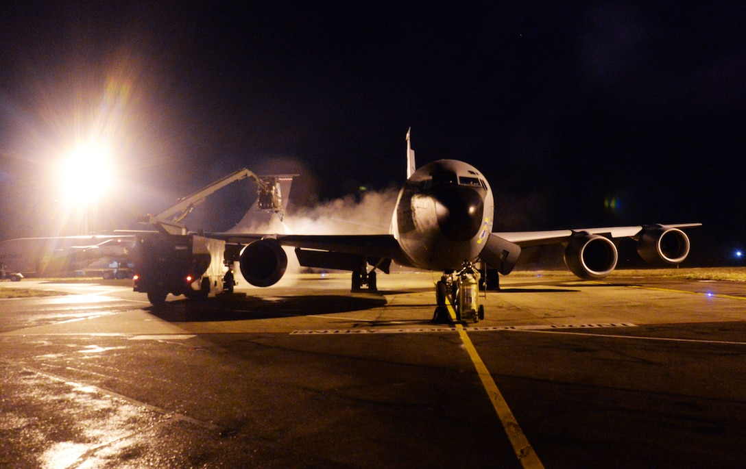 A U.S. Air Force KC–135 Stratotanker assigned to the 351st Air Refueling Squadron is de-iced during a readiness exercise at RAF Mildenhall, England, Feb. 26, 2018.  The exercise tested the wing's ability to rapidly mobilize an entire wing and prepare to launch KC- 135 Stratotankers in response to an international incident. (U.S. Air Force photo by Airmen 1st Class Alexandria Lee)