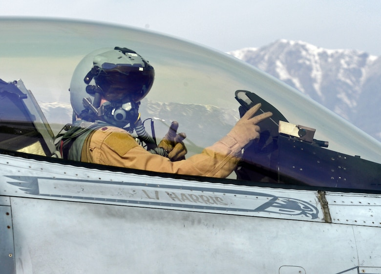 """Mach"", 77th Expeditionary Fighter Squadron F-16 Fighting Falcon fighter pilot, signals from his aircraft prior to taking off Feb. 28, 2018 at Bagram Airfield, Afghanistan."