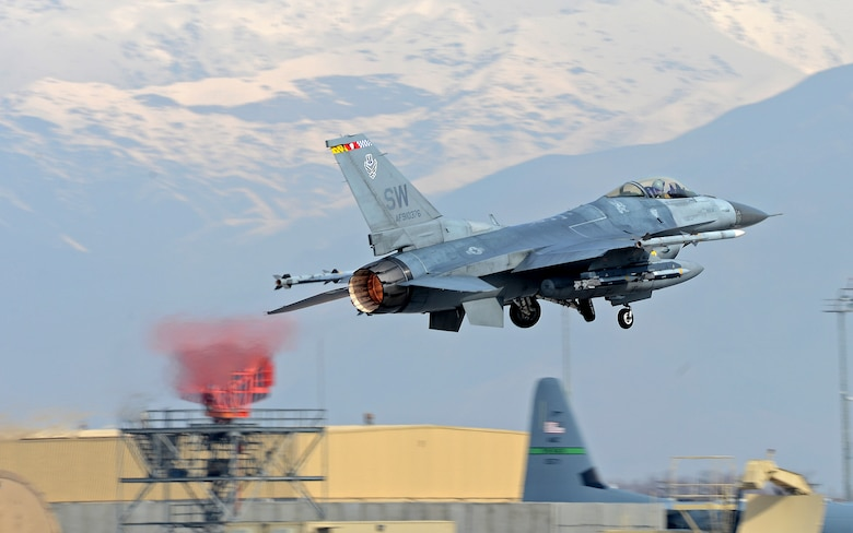 """Mach"" (center), 77th Expeditionary Fighter Squadron F-16 Fighting Falcon fighter pilot, takes off from Bagram Airfield, Afghanistan Feb. 28, 2018."