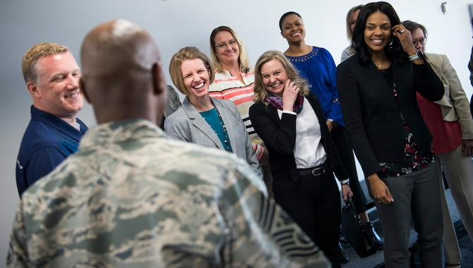 Spouses of the 2017 Air Force Space Command chief master sergeant selects laugh in response to a joke by Chief Master Sgt. of the Air Force Kaleth O. Wright March 6, 2018 at Peterson Air Force Base, Colo. Chief Wright visited Peterson to mentor and welcome 11 of Air Force Space Command's 2017 chief master sergeant selects during the command-wide chief and spouses orientation course. (Photo by Tech. Sgt. David Salanitri)