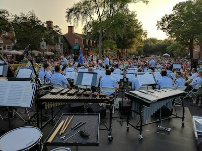 The USAF Heritage of America Band performs before a capacity crowd at a recent outdoor concert in Merchants Square, Williamsburg, Virginia.  The band regularly performs in the Hampton Roads region during the summer months.