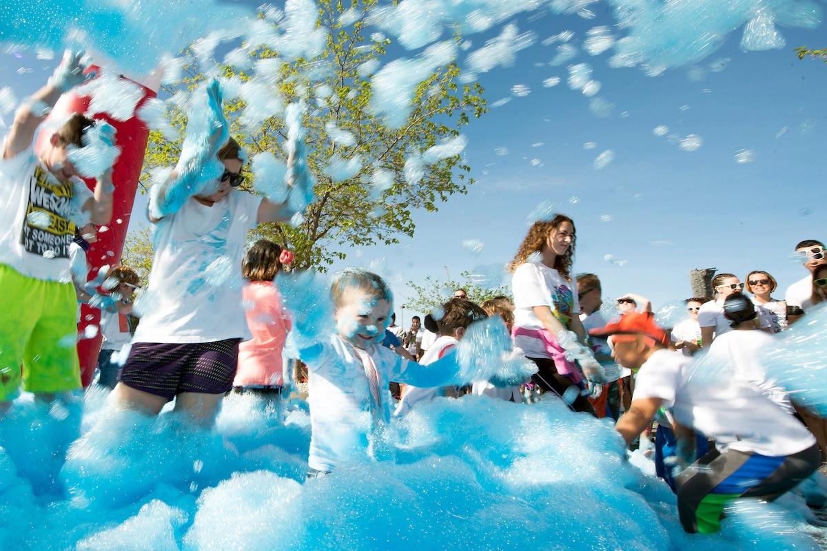 Children play in colored foam.