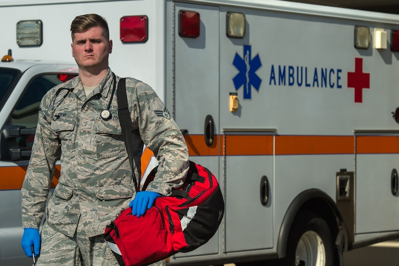 U.S. Air Force Senior Airman Michael Bray 633rd Medical Operations Squadron emergency medical technician, poses in front of the Langley Hospital at Joint Base Langley-Eustis, Feb. 22, 2018.