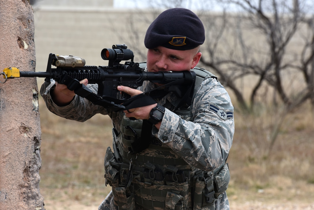 U.S. Air Force Airman 1st Class Dalton Combs, 17th Security Forces Squadron, takes cover and while watching for enemy forces during the final training exercise at the mock Forward Operating Base on Goodfellow Air Force Base, Texas, Feb. 28, 2018. The students in the Warrior Ancillary Specialized Training Program practiced covering techniques while moving forward on enemy forces and retreating. (U.S. Air Force photo by Airman 1st Class Seraiah Hines/Released)