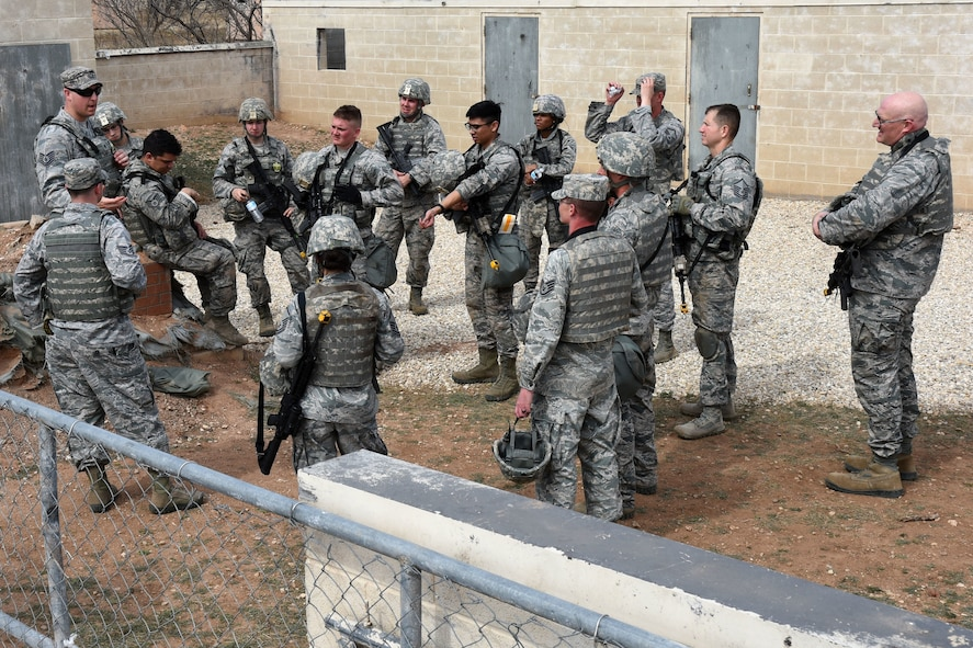 U.S. Air Force Tech. Sgt. Mark Karas, 17th Security Forces Squadron noncommissioned officer in charge of training, delivers a brief after the final training exercise for the Warrior Ancillary Specialized Training Program at the mock Forward Operating Base at Goodfellow Air Force Base, Texas, Feb. 28, 2018. The students were given a breakdown of how they functioned as a team during the exercise. (U.S. Air Force photo by Airman 1st Class Seraiah Hines/Released)