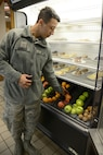 Airman Jarron Hannan, with the 72nd Dental Squadron, grabs an apple for an afternoon snack at the Vanwey Dining Facility. The Vanwey offers fresh fruits such as apples, oranges, bananas, kiwi and pineapple.