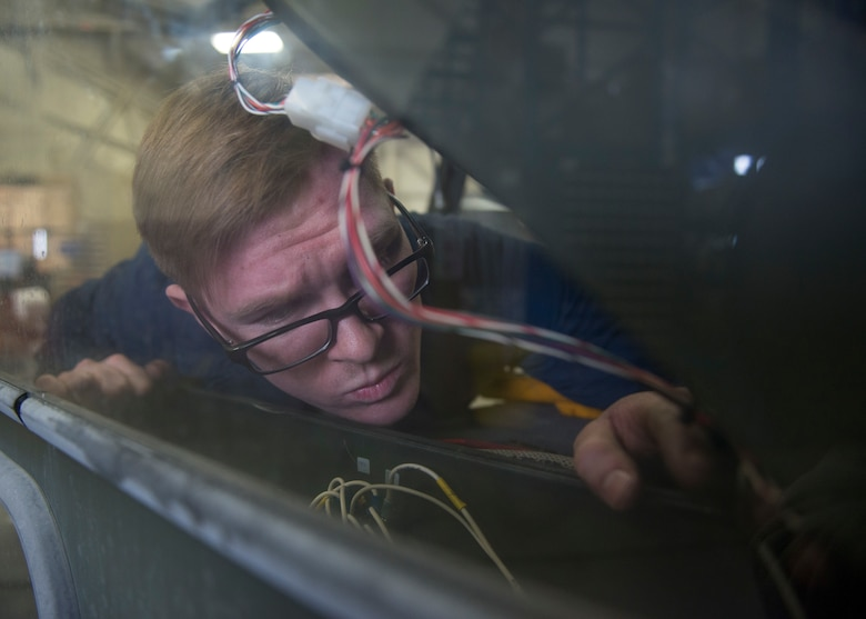 Airman 1st Class Craig Boudreau, a vehicle maintainer with the 673d Logistics Readiness Squadron, replaces a circuit breaker on a Global de-icer 1800 March 6, 2018, at Joint Base Elmendorf-Richardson, Alaska. Boudreau was handpicked to travel with an extended-reach deicer from Joint Base Elmendorf-Richardson, Alaska, to Gangneung Air Base, Republic of Korea, in support of Vice President of the United States Michael Pence's visit to the Pyeongchang 2018 Winter Olympics.