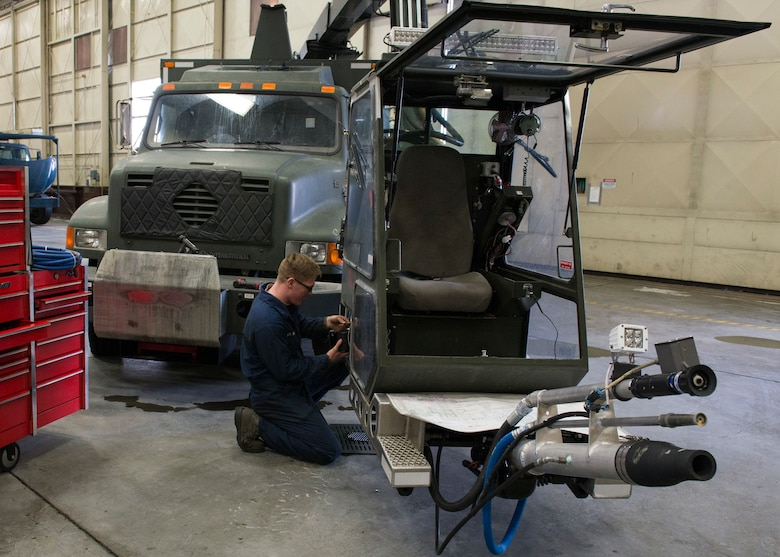 Airman 1st Class Craig Boudreau, a vehicle maintainer with the 673d Logistics Readiness Squadron, replaces a heater on a Global de-icer 1800 March 6, 2018, at Joint Base Elmendorf-Richardson, Alaska. Boudreau was handpicked to travel with an extended-reach deicer from Joint Base Elmendorf-Richardson, Alaska, to Gangneung Air Base, Republic of Korea, in support of Vice President of the United States Michael Pence's visit to the Pyeongchang 2018 Winter Olympics.