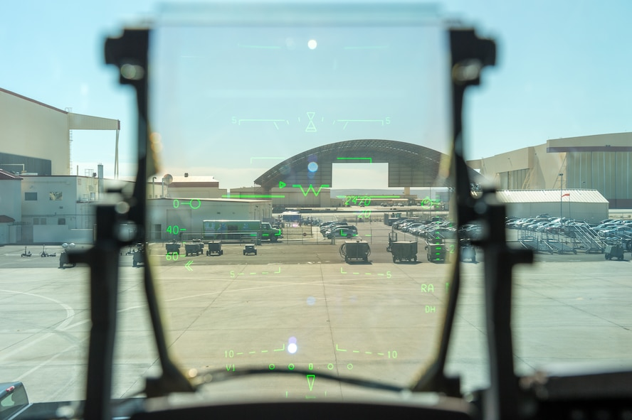 The view of the wash rack on the Edwards flight line through the Replacement Head-Up Display on an a C-17 Globemaster III. The Air Force is looking to see if the RHUD can supplant the legacy display with a newer, more capable version. (U.S. Air Force photo by Kyle Larson)