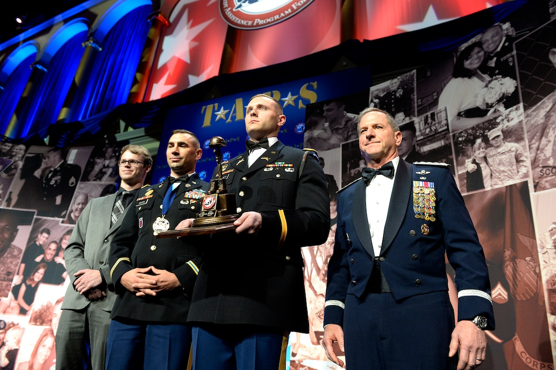Chief of Staff of the Air Force Gen. David L. Goldfein accepts the Tragedy Assistance Program for Survivors Honor Guard Military Award on behalf of the Air Force's 670,000 Airmen and their families during the 10th Annual TAPS Honor Guard Gala March 6, 2018, in Washington, D.C. The award recognized the Air Force's enduring commitment to families of fallen. (U.S. Air Force photo by Staff Sgt. Rusty Frank)
