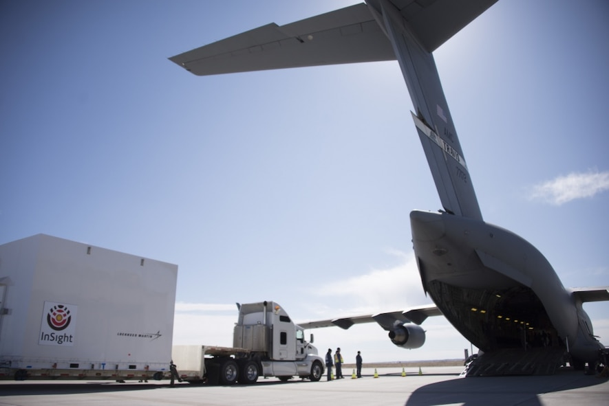Airmen from the 21st Airlift Squadron and the 860th Aircraft Maintenance Squadron at Travis Air Force Base, California, load a NASA InSight Spacecraft onto a C-17 Globemaster III Feb. 28, 2018, at Lockheed Martin Space, Buckley Air Force Base, Colorado. The equipment was delivered to Vandenberg Air Force Base, Calif., where it will be the first planetary spacecraft to launch from the West Coast launch facility. The launch is scheduled to take place in May 2018 as part of the NASA Insight Mission to look beneath the Martian surface and study the planet's interior. (U.S. Air Force photo by Senior Airman Amber Carter)