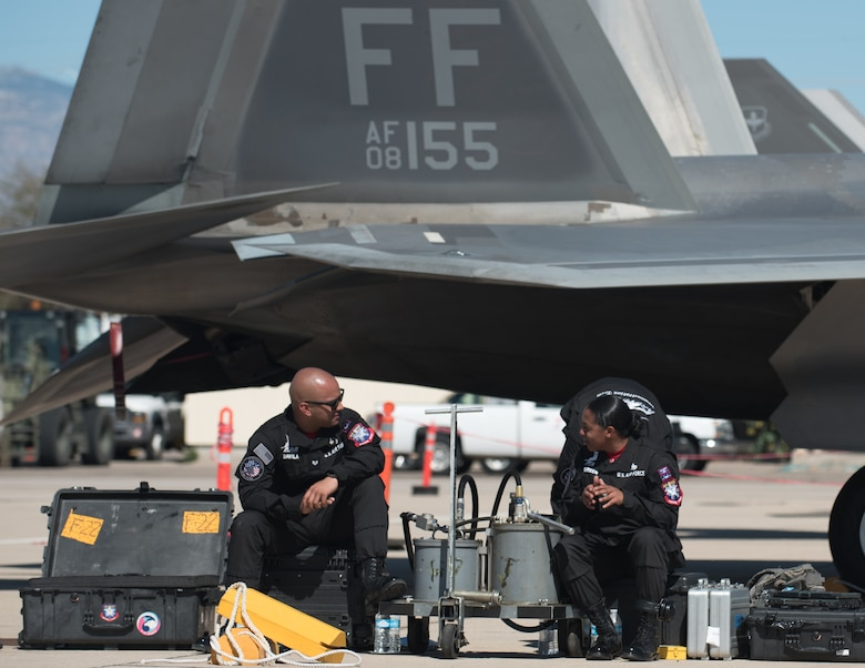 Members of the Air Combat Command F-22 Raptor Demonstation Team, take a break after launching the F-22 Raptor during the Heritage Flight Training Course at Davis-Monthan Air Force Base, Arizona, March 1, 2017.