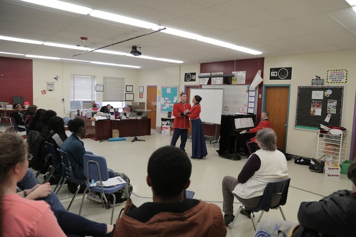 """On March 7, 2018 vocalists from """"The President's Own"""" U.S. Marine Band performed a Music in the High Schools program at Bowie High School in Bowie, Md. (U.S. Marine Corps photo by Master Sgt. Kristin duBois/released)"""