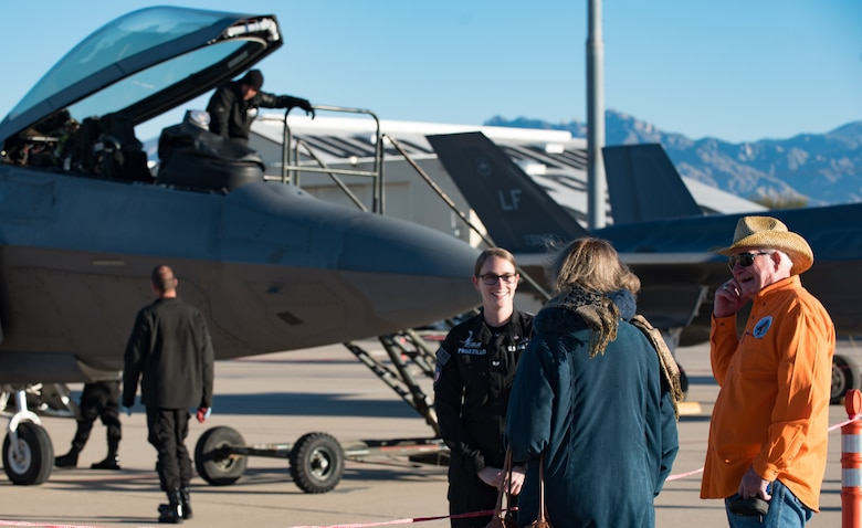 U.S. Air Force Guard Senior Airman Annemarie Prozillo, Air Combat Command Raptor Demostration Team aircrew flight equipment technician, speaks with U.S. Air Force Heritage Flight Training Course attendees at Davis-Monthan Air Force Base, Arizona, March 2, 2017.