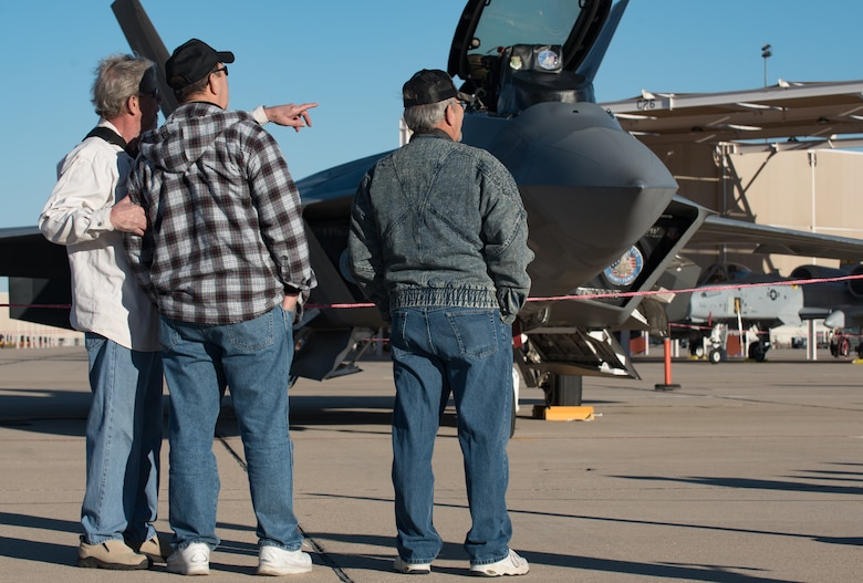 U.S. Air Force Heritage Flight Training Course spectators visit the Air Combat Command F-22 Raptor Demonstration Team before the Raptor team's flight at Davis-Monthan Air Force Base, Arizona, March 2, 2017.