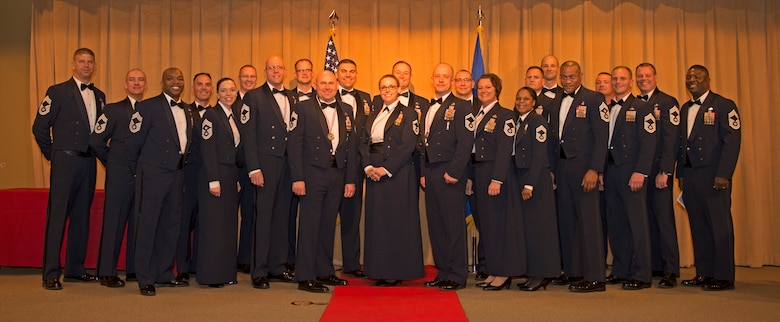 Chief selectees stand for a photo with other Chief Master Sgts. from both Luke Air Force Base, Ariz., and around the Air Force during the Luke Chief Recognition Ceremony, March 3, 2018. Chief Master Sgt. Juliet Gudgel, command chief of the Air Education and Training Command, fifth from left, was the guest speaker at the ceremony. (U.S. Air Force photo/Senior Airman Ridge Shan)