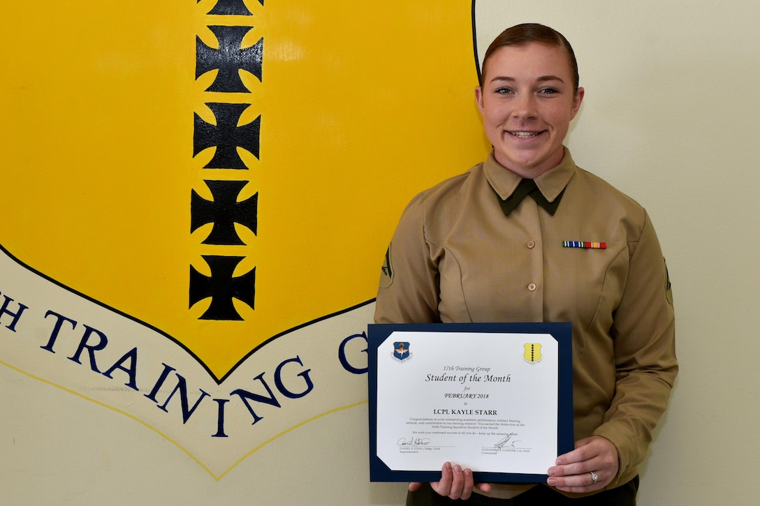 17th Training Group Student of the Month for Feb. 2018, U.S. Marine Corps Lance Cpl. Kayle Starr, Marine Corps Detachment at Goodfellow trainee, stands in Brandenburg Hall on Goodfellow Air Force Base, Texas, March 2, 2018. Starr is the Goodfellow Student of the Month spotlight for Feb. 2018, a series highlighting Goodfellow students.   (U.S. Air Force photo by Senior Airman Randall Moose/Released)
