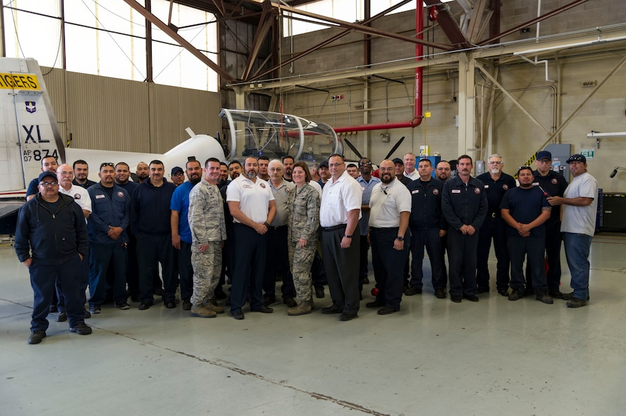 "Benjamin Gonzalez IV, 47th Maintenance Directorate swing shift productions supervisor, was chosen by wing leadership to be the ""XLer"" of the week, for the week of Feb. 26, 2018, at Laughlin Air Force Base, Texas. The ""XLer"" award, presented by Col. Charlie Velino, 47th Flying Training Wing commander, is given to those who consistently make outstanding contributions to their unit and the Laughlin mission. (U.S. Air Force photo/Airman 1st Class Daniel Hambor)"