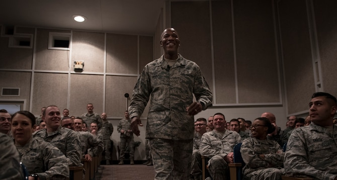 Chief Master Sgt. of the Air Force Kaleth O. Wright walks down the aisle of the base auditorium during an all call at Peterson Air Force Base, Colo., March 6, 2018. Wright spoke on matters concerning Airmen such as uniforms, professional military education and physical fitness standards. (U.S. Air Force photo by Senior Airman Dennis Hoffman)