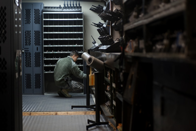 An Airman assigned to the 48th Security Forces Squadron's armory returns gear to its labeled location at Royal Air Force Lakenheath, England, Feb. 20. Armory Airmen are responsible for all of the 48th SFS weapons. (U.S. Air Force photo/Airman 1st Class Eli Chevalier)