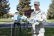 U.S. Air Force Tech. Sgt. Eduardo Ausmann, 39th Medical Support Squadron bioenvironmental engineering flight NCO in charge, collects a radiological background reading with a Radeco high volume air sampler at Incirlik Air Base, Turkey, March 8, 2018.