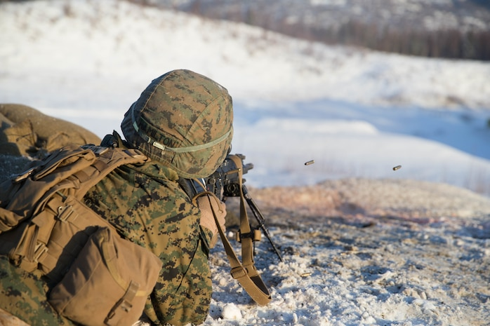 U.S. Marine Corps Lance Cpl. Wesley Hamilton with Kilo Company, 3rd Battalion, 8th Marine Regiment, 2nd Marine Division fires his M27 Infantry Automatic Rifle (IAR) at targets during Infantry Squad Battle Course (ISBC) range on Joint Base Elmendorf-Richardson (JBER), Ala., March 5. 2018. Marines with Kilo Co. conduct squad attacks during ISBC for Arctic Edge-18 in order to enhance combat readiness and effectiveness in an extreme cold weather environment.