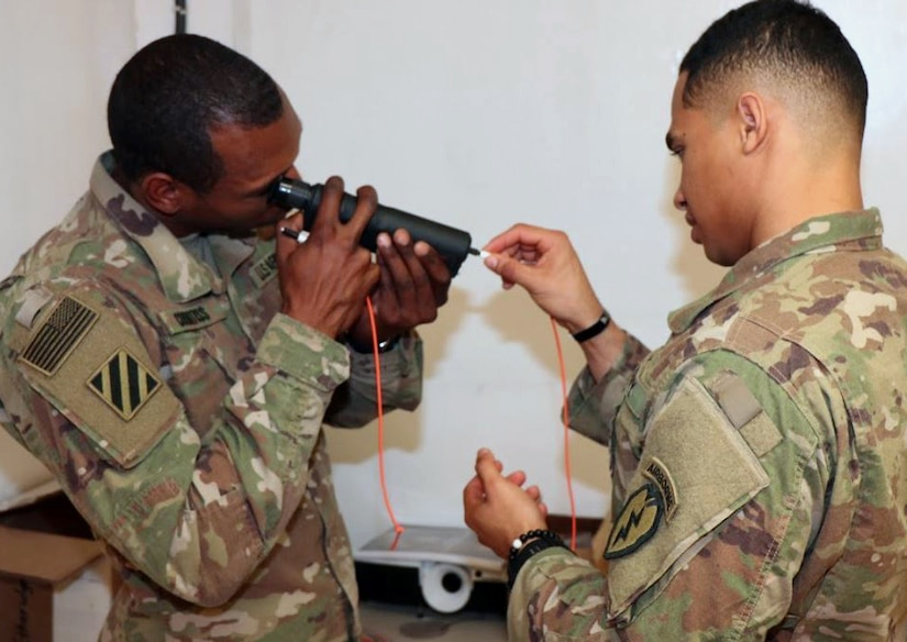 U.S. Army Soldiers conduct hands-on training during first fiber optics installers course.