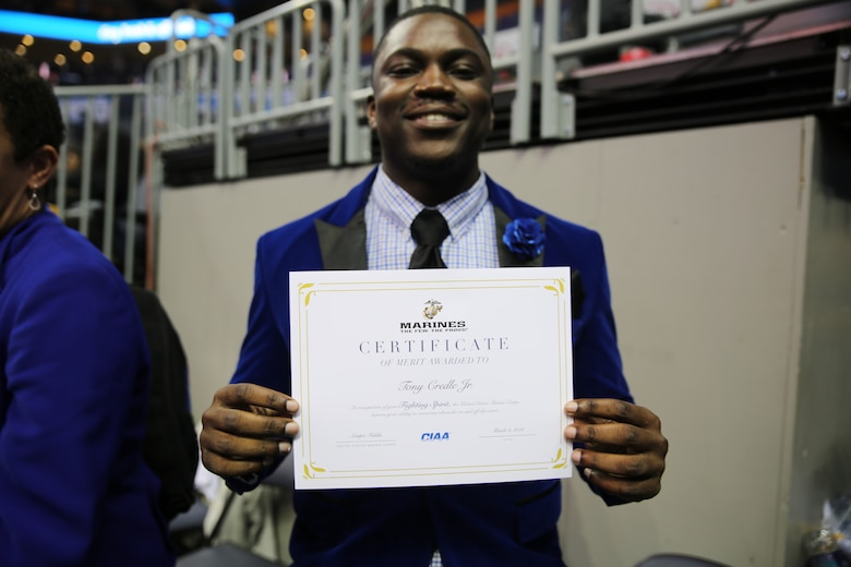Tony Credle Jr. poses with his certificate of merit during the men's semifinals of the Central Intercollegiate Athletic Association (CIAA) Basketball Tournament at the Spectrum Center in Charlotte, March 2. During the tournament, the CIAA also took time to recognize the contributions and successes of 100 years of women in the Marine Corps with a presentation during the men's semifinals. The CIAA Basketball Tournament is scheduled for Feb. 27 to March 3, 2018 in Charlotte. Credle is a senior at Fayetteville State University.