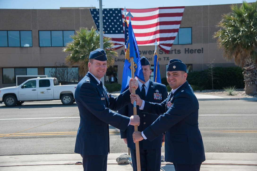 Lieutenant Colonel Andrew Katz formally assumed command of the 47th Operations Support Squadron during a transfer of responsibility, March 2, 2018, here. This type of formal military event, dated back to Frederick the Great of Prussia, includes the passing of a flag to the new commander to signify a public assumption of command. (U.S. Air Force photo/Airman 1st Class Daniel Hambor)