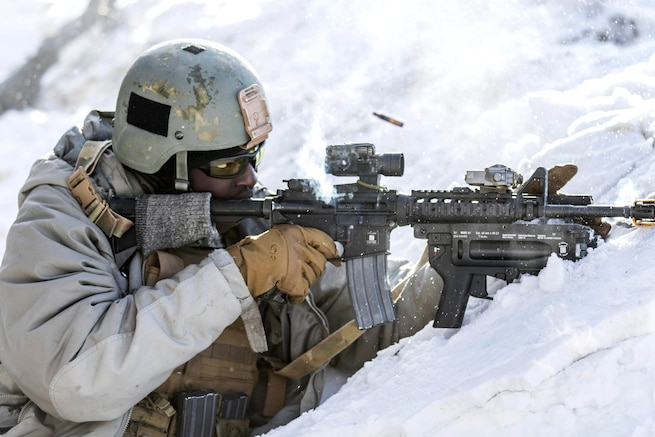 A soldier fires blank rounds at opposing forces.