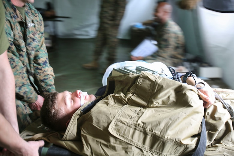 U.S. Navy doctors and hospital corpsmen simulate transporting a wounded service member for a medical evacuation after being stabilized by doctors and hospital corpsmen with 2nd Medical Battalion, 2nd Marine Logistics Group, during a certification exercise at Camp Lejeune, N.C., March 1, 2018. The exercise was designed for shock trauma platoons and forward resuscitation surgical units to ensure the unit sustains medical proficiency and is capable of handling emergencies in future deployments.