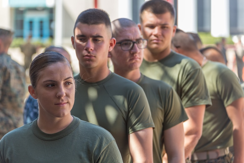 U.S. Marine Pfc. Kira Kozik, the first female Marine student to check in to School of Infantry – West, stands in line to turn in her medical records on Camp Pendleton, March 6, 2018. This marks the first male-female integrated Marine Combat Training company on the West Coast.