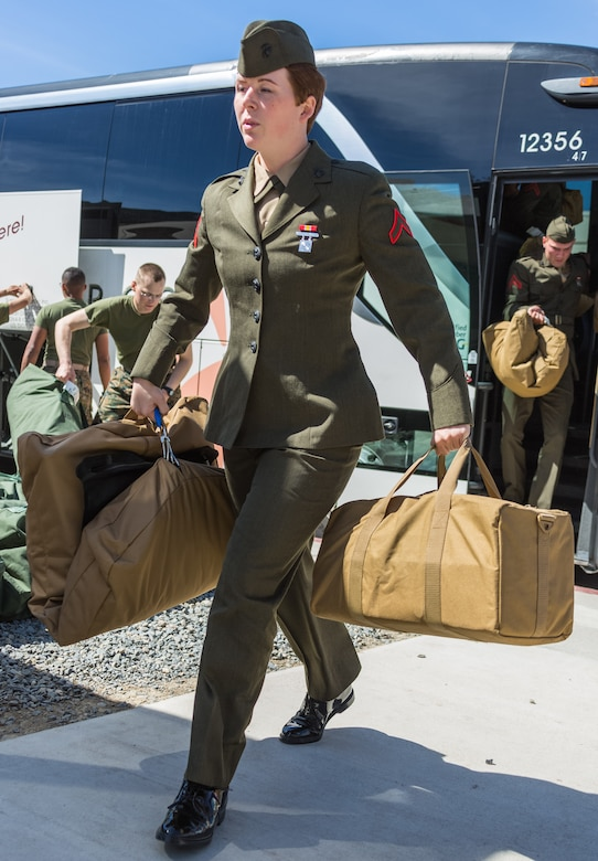U.S. Marine Pfc. Savana Anderson steps off the bus to the School of Infantry - West on Camp Pendleton, Calif., March 6, 2018. This marks the first male-female integrated Marine Combat Training company on the West Coast.