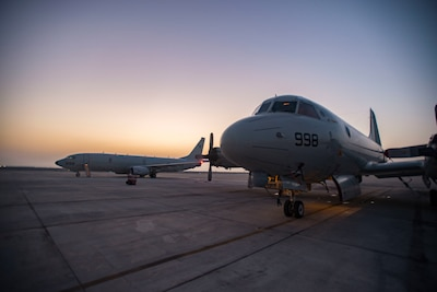 A P-3 Orion, left, assigned to Patrol Squadron (VP) 40, sits on the flight line adjacent to a P-8A Poseidon from Patrol Squadron (VP) 5. The 'Mad Foxes' of VP 5, detached from Commander, Task Force (CTF) 67 to CTF 57, are supporting missions in U.S. 5th Fleet to demonstrate cross-combatant command interoperability, deter potential adversaries and to provide large-scale intelligence, surveillance and reconnaissance collection. (Photo by Mass Communication Specialist 2nd Class Jakoeb Vandahlen)