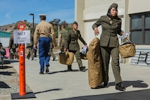 U.S. Marines walk off the bus to start their check-in process for Marine Combat Training at the School of Infantry - West on Camp Pendleton, Calif., March 6, 2018. This marks the first male-female integrated Marine Combat Training company on the West Coast.