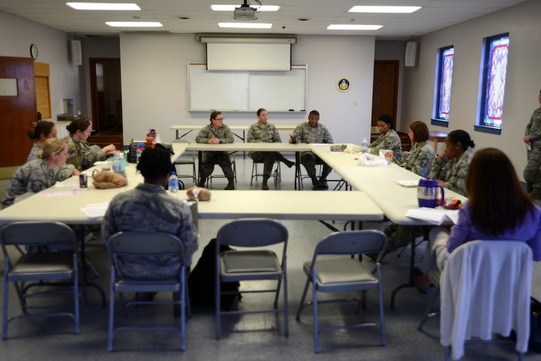"""Team Shaw members participate in a discussion about mental health, deployment and spouse programs during a """"Let's Connect Shaw"""" Women's Mentorship Forum at Shaw Air Force Base, S.C., Feb. 22, 2018. The lunch and learn was an opportunity for Airmen and spouses to meet in an open forum with subject matter experts from the Mental Health clinic, the Airman and Family Readiness Center and other installation organizations. (U.S. Air Force photo by Senior Airman Kelsey Tucker)"""