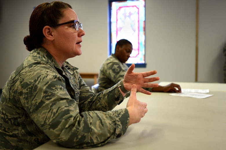 """U.S. Air Force Capt. Shirley Ziser, 20th Medical Operations Squadron mental health provider, speaks during a """"Let's Connect Shaw"""" Women's Mentorship Forum at Shaw Air Force Base, S.C., Feb. 22, 2018. Ziser, along with other subject matter experts, helped lead the discussion based on the mental domain of Comprehensive Airman Fitness. (U.S. Air Force photo by Senior Airman Kelsey Tucker)"""