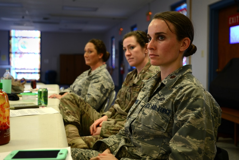 """U.S. Air Force Maj. Amanda Pelkowski, 20th Force Support Squadron operations officer, listens to a speaker during a """"Let's Connect Shaw"""" Women's Mentorship Forum at Shaw Air Force Base, S.C., Feb. 22, 2018. Pelkowski was one of many women from across Team Shaw that attended the lunch and learn in order to participate in discussions about mental health, deployment and spouse programs at Shaw. (U.S. Air Force photo by Senior Airman Kelsey Tucker)"""