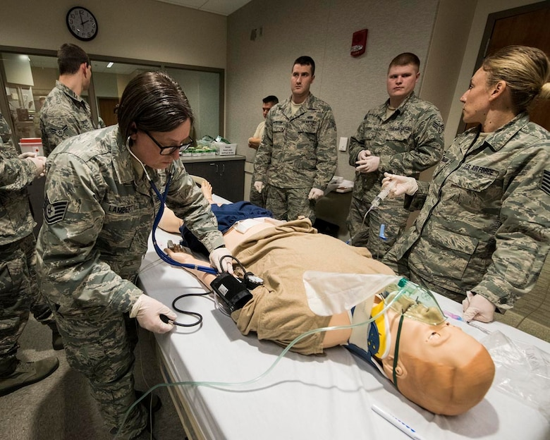 Tech. Sgt. Linda Lambert, an aerospace medical service technician at the 92nd Medical Group, checks vitals on a mannequin in a simulation lab March 4, 2018 at the Washington State University College of Nursing Riverpoint Campus in Spokane, Wash. More than 45 nurses, medics and medical providers from the 141st MDG as well as seven medical personnel assigned to the 92nd MDG teamed up for the combined training during March's unit training assembly. (U.S. Air National Guard photo by Staff Sgt. Rose M. Lust)