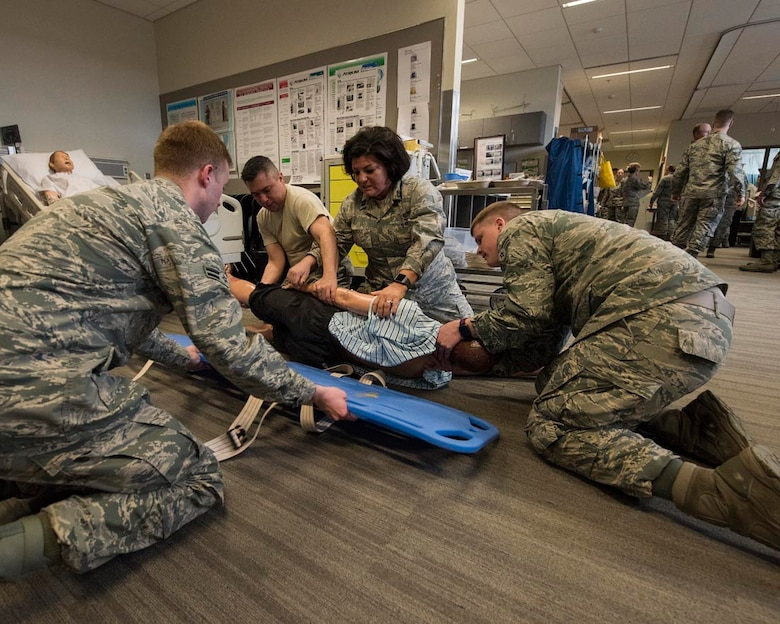 Guardsmen from the 141st Medical Group practice patient transport March 4, 2018 at the Washington State University College of Nursing Riverpoint Campus in Spokane, Wash. More than 45 nurses, medics and medical providers from the 141st MDG as well as seven medical personnel assigned to the 92nd MDG teamed up for the combined training during March's unit training assembly. (U.S. Air National Guard photo by Staff Sgt. Rose M. Lust)