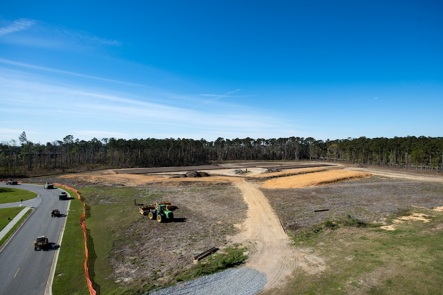 Vehicles drive past the construction site for the new rescue complex, March 7, 2018, at Moody Air Force Base, Ga. The base is improving the Guardian Angel's capabilities by building them new facilities to group the rescue assets closer together, so as to help better prepare for the future of their mission of saving lives. (U.S. Air Force photo by Airman 1st Class Erick Requadt)