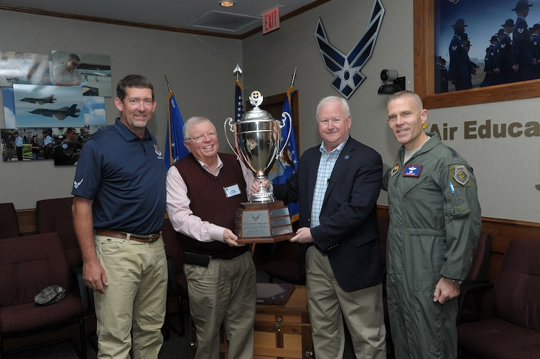 U.S. Air Force Lt. Gen. Steve Kwast, commander of Air Education and Training Command, (at right) and Dr. Joe Leverett, Altus Trophy committee chairman announced Biloxi, Mississippi, as the 2017 Altus Trophy winner and presented the award to John Boothby and Lenny Sawyer of the Biloxi Bay Area Chamber of Commerce at Joint Base San Antonio-Randolph, Texas, March 8, 2018. The Altus Trophy is given to the community judged to have shown outstanding support to an AETC base. (U.S. Air Force photo by Joel Martinez)