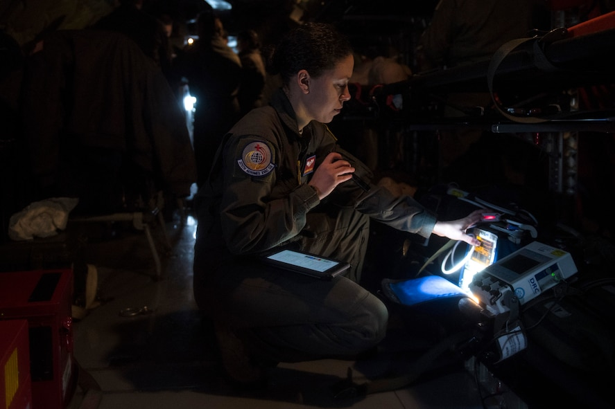Staff Sgt. Kendra Fulton, 375th Aeromedical Evacuation Squadron technician, inspects the pulse oximeter as well as other medical equipment to confirm proper functionality during an aeromedical evacuation training at Fairchild Air Force Base, Washington, March 1, 2018. It is a top priority to ensure all medical gear can help AE Airmen provide care while patients are transported. (U.S. Air Force photo/Airman 1st Class Whitney Laine)